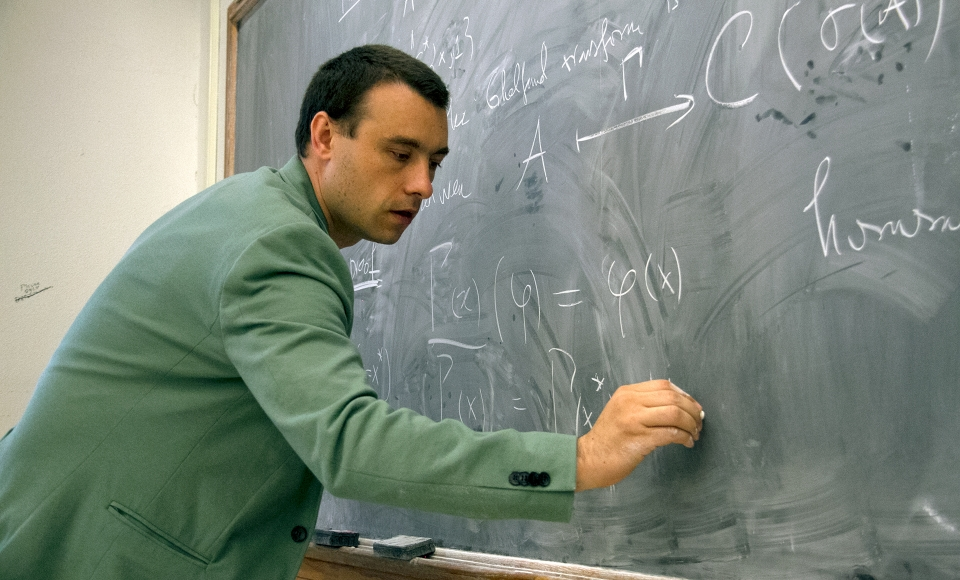Ionut Chifan using the chalkboard during lecture