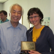 Prof. Lin and Katya pose for a photo following the presentation