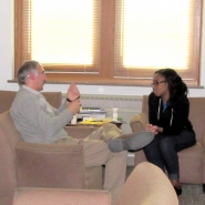 Prof. Durumeric in a discussion with undergraduate awardee Porscha Brown